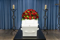 Coffin in morque a with a flower arrangement a morgue and a burning candle front Royalty Free Stock Photography