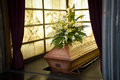 Coffin wooden with funeral flowers in crematorium Royalty Free Stock Photos
