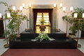 Coffin wooden with funeral flowers in crematorium Royalty Free Stock Photography
