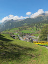 Cog-wheel train and Village View in Switzerland Stock Image