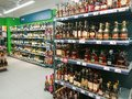 Cognac, brandy, wine and other alcoholic beverages on the shelves in the store.