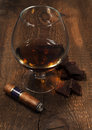 Cognac with a cigar Stock Images