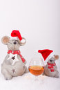 Cognac glass with christmas mice in snow happy vertical format Stock Image