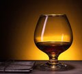 Cognac glass of with old love letters Stock Photography