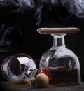 Cognac glass shrouded in a smoke on black background Royalty Free Stock Photo