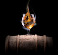 Cognac glass shrouded in a smoke on black background Royalty Free Stock Photos