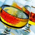 Cognac glasses with liquor closeup of some Royalty Free Stock Photography