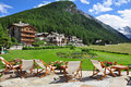 Cogne mountain holiday resort aosta valley italy the town of beach chairs on a luxury hotel terrace and garden italian alps region Royalty Free Stock Photos