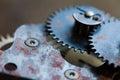 Cogs wheels machinery, rusty iron mechanism. Black metal gears close-up photo. Shallow depth field. Selective focus.