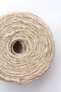 Coil of linen twine on white background closeup Stock Images