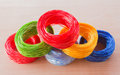 Coil of plastic rope on the wooden floor Royalty Free Stock Photo