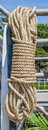 Coil of rope hanging on steel Stock Photo