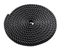 Coiled black rope neatly forming a perfect circle and showing the texture of the interwoven and braided fibres on white Stock Images