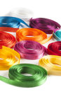 Coiled colorful spools of ribbons on a white background Royalty Free Stock Photo