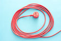 Coiled red electrical cable or lead with plug Royalty Free Stock Photo
