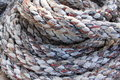 Coiled rope a on the deck of a ship Stock Image