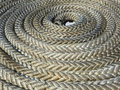 Coiled rope on ship deck Royalty Free Stock Photo