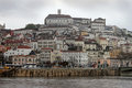 Coimbra under dark skies view of the city of portugal and river Royalty Free Stock Images