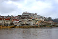 Coimbra under dark skies view of the city of portugal and river Stock Photo