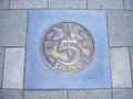 Coin of five cents in pavement Royalty Free Stock Photo