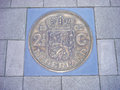 Coin of guilders in pavement former dutch piece cemented sidewalk Stock Image