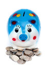Coin and piggy bank Royalty Free Stock Photography