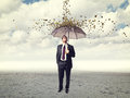 Coin rain man with umbrella and Stock Photos
