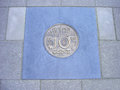 Coin of ten cents in pavement former dutch cemented sidewalk Royalty Free Stock Photography