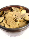 Coins in ancient bowl Royalty Free Stock Image