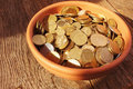 Coins on brown baclground of wooden Royalty Free Stock Photos