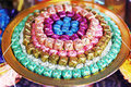 Coins in colorful ribbin in a gold bowl for Newly ordained Buddhist monks Royalty Free Stock Photo