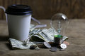Coins and crumpled money tungsten lamp filament Royalty Free Stock Photo