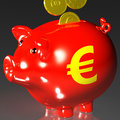 Coins entering piggybank shows european loans and finances Royalty Free Stock Photo