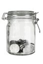 Coins in glass jar on white background Stock Image