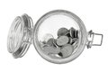 Coins in glass jar on white background Royalty Free Stock Photos