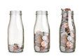Coins of jars with different level isolated on white Stock Photo