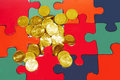 Coins with puzzle Royalty Free Stock Images