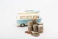 Coins and saving box a mini van with baht Royalty Free Stock Image