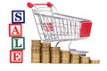 Coins and shopping cart and word SALE Stock Photos