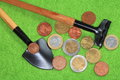 COINS, SHOVEL, RAKE. Royalty Free Stock Image
