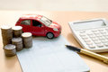 Coins stack in columns, saving book, car. Finance and banking co Royalty Free Stock Photo