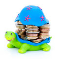 Coins stacked on turtle Royalty Free Stock Photo