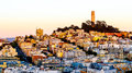 Coit tower and houses on the hill san francisco at dusk Royalty Free Stock Photo