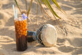 Coke cocktail still life on a sunny beach Stock Photography
