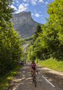 Col du granier france july th amateur female cyclist climbing road to mountain pass granier passing peloton stage th la tour de Royalty Free Stock Images