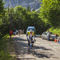 Col du granier france july th british amateur female cyclist climbing road to mountain pass granier passing peloton stage th la Royalty Free Stock Image