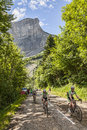 Col du granier france july th group three amateur cyclists climbing road to mountain pass granier passing peloton stage th la tour Stock Images