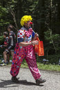 Col du granier france july th man funny disguised as clown walking road to mountain pass granier passing peloton th stage le tour Royalty Free Stock Image