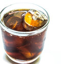 Cola with ice in cup on white background Stock Image