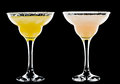 Cold alcoholic cocktail a couple of identical cocktails on the black background Royalty Free Stock Photo